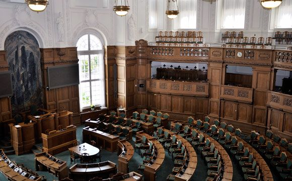 Government and Politics The political system of Denmark is that of a multi-party structure, where several parties can be represented in Parliament at any one time. Danish governments are often characterised by minority administrations, aided with the help of one or more supporting parties. This means that Danish politics is based on consensus politics. Since 1909, no single party has had the majority in Parliament.