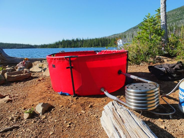 """The Original Nomad heater coil is a hot water on demand unit that can be heated with propane or firewood. It's constructed from 1.25"""" stainless steel and uses t"""