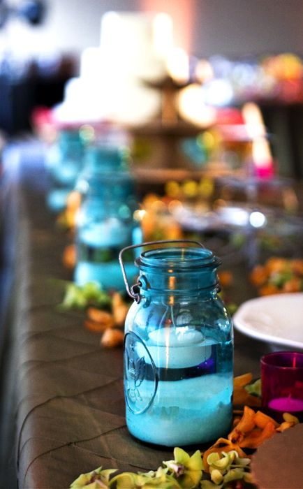 Blue ball mason jars with sand water and floating