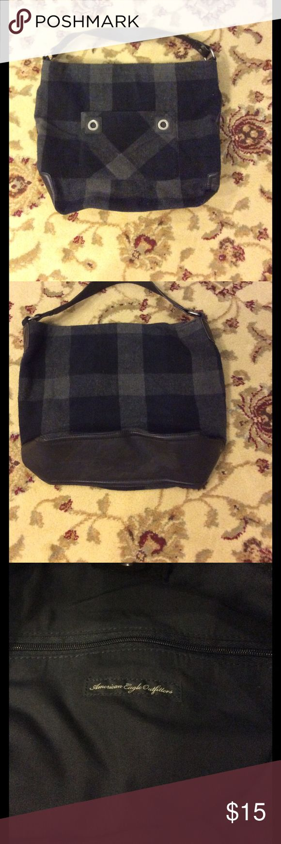 """🦅 American Eagle Outfitters Purse/Tote Bag 🦅 Perfect size bag for a variety of uses!  This new bag features a gray/black plaid flannel pattern fabric, 1 exterior pocket, 2 interior open pockets, 1 interior zippered pocket & faux leather handle & bottom.  Measures 16"""" x 14"""" x 4 1/2"""" with a 16 1/2"""" handle. American Eagle Outfitters Bags Totes"""