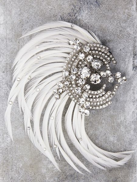 Art Deco Feathered Headpiece -- Even the Great Gatsby would take a second look at you. Inspire the romance of the roaring 20's with this stunning Art Deco hairpiece. Crafted with genuine feathers and Swarovski Crystals, you will steal the night from the stars.