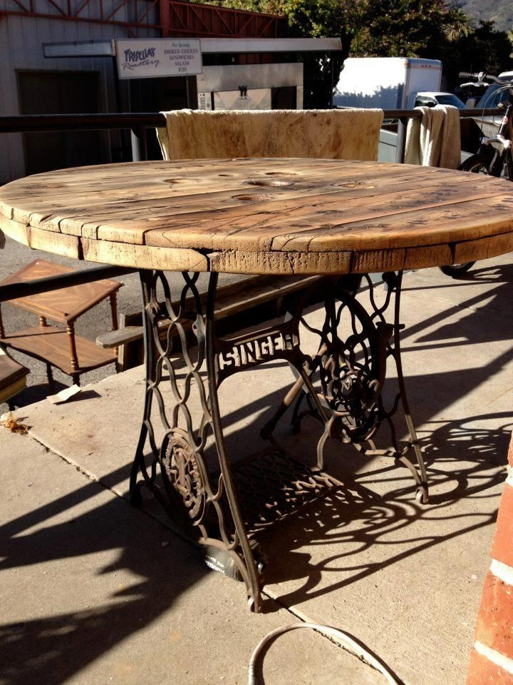 Recycle table made from pallet board and bottom of sewing machine (legs off treadle sewing machine).