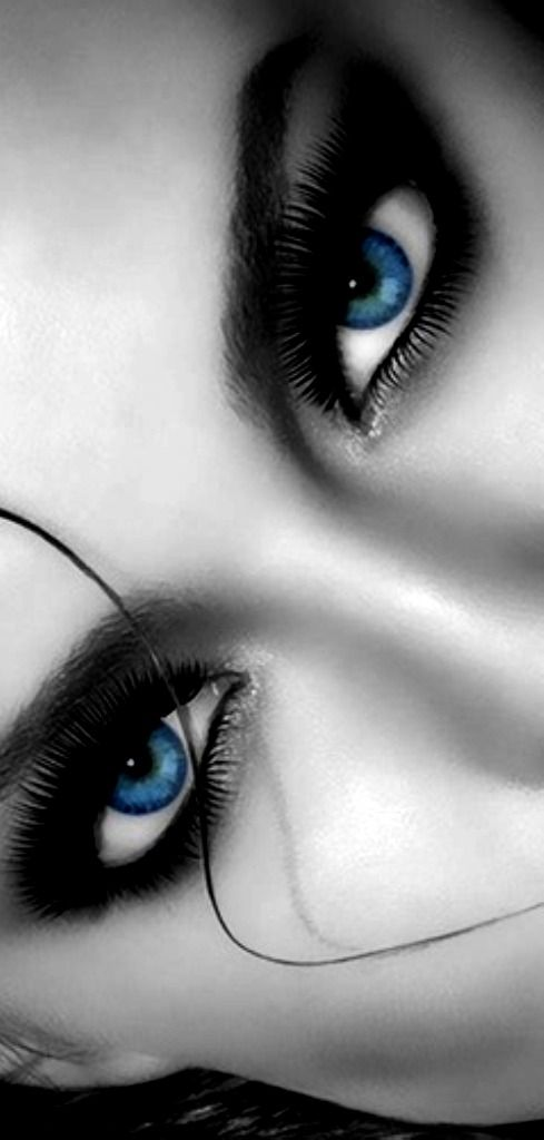 This picture shows color because the vibrant shade of the womans eyes is brought to attention since the rest of the picture is in black and white