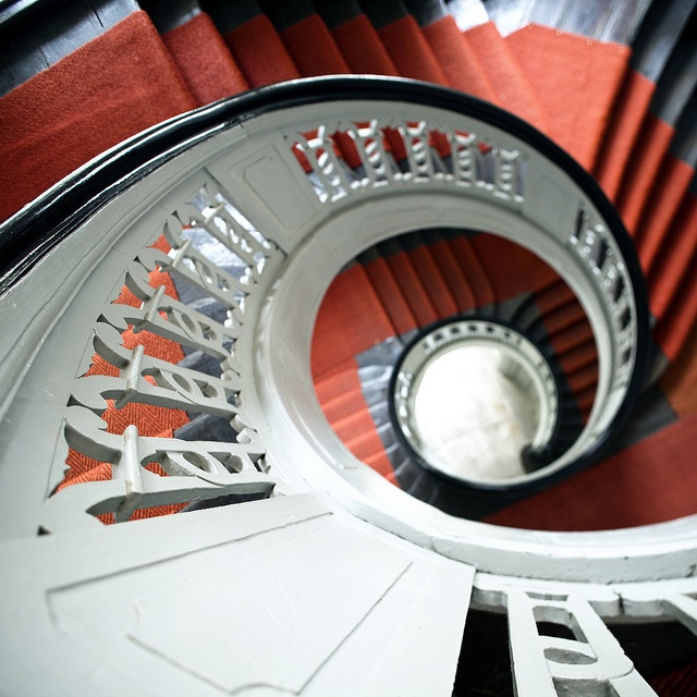 spiral staircase in white, black and red