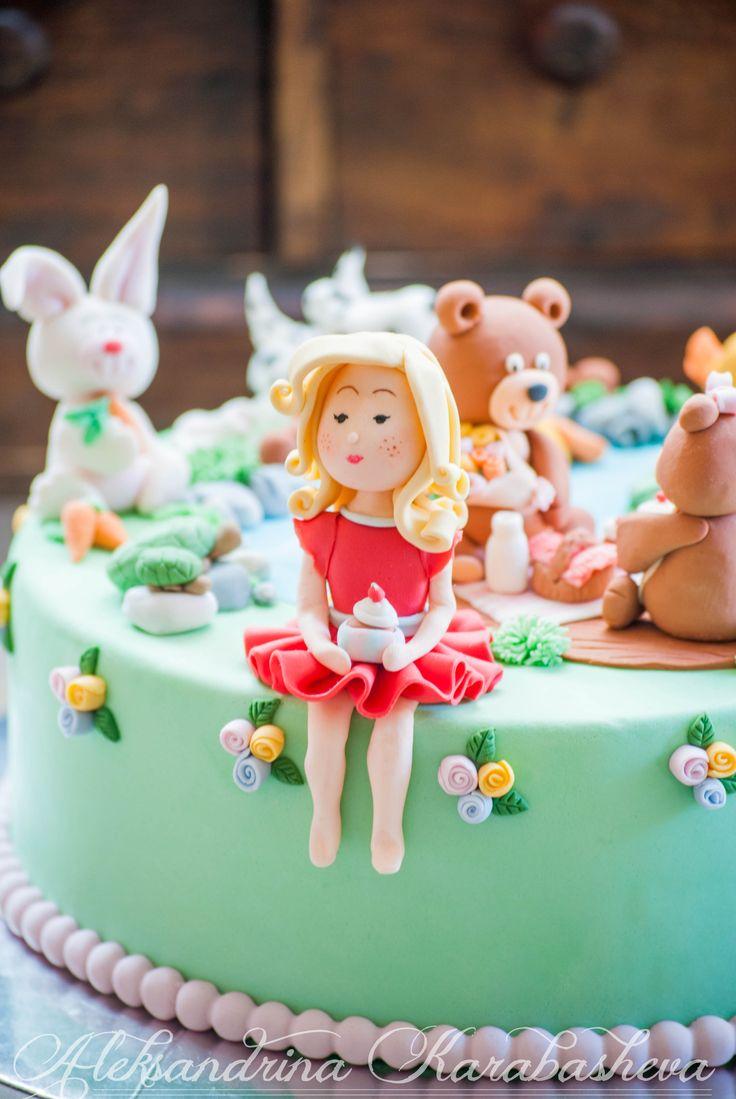 Children's cake with fondant figures - fondant animals, fondant bear, fondant girl.