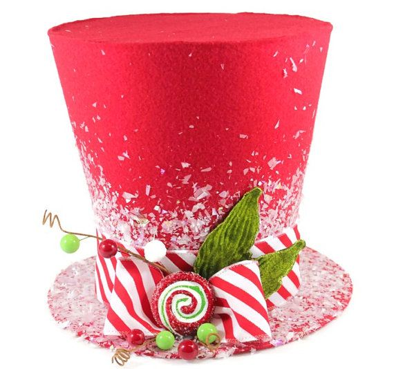 "Sweeten your holiday this year with a Candy Christmas tree. This brightly colored whimsical top hat is perfect as a tree topper, table decoration, you can even use it as a vase for your centerpiece on a table. Hold flowers (vase is needed to preserve the condition of the hat) A Candy Christmas tree theme has whimsical appeal, and as long as the kiddies dont try to take a small taste, your sugary sweet ornaments will be eye candy all season long  1. 5"" best fit for a 2ft or decorative display…"