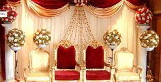 Stage Decoration and Backdrop | Red and golden stage decorated with bead work and flowers