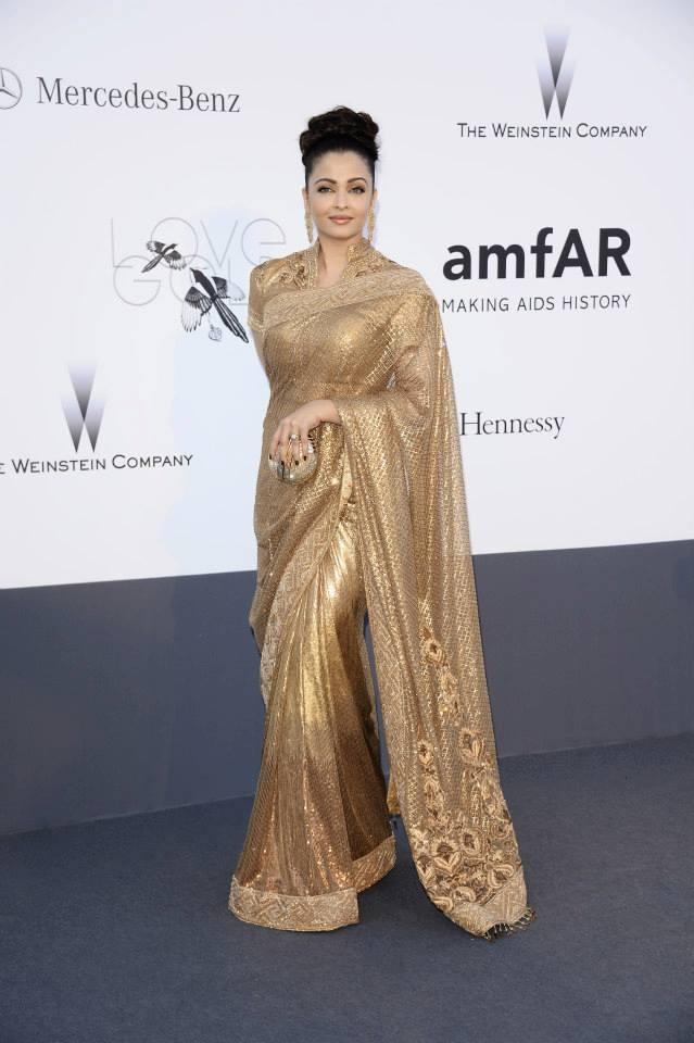 Aishwarya Rai looks graceful & gorgeous in the gold Sari at Cannes 2013