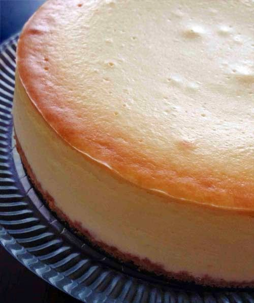 Traditional New York Cheesecake. Thick and creamy, an easy classic recipe using Philadelphia cream cheese by Kraft with Graham Crackers crust (original recipe uses Oreo cookies). Can be served plain or with any topping. A quick tip for lemon jello topping is included in the website.
