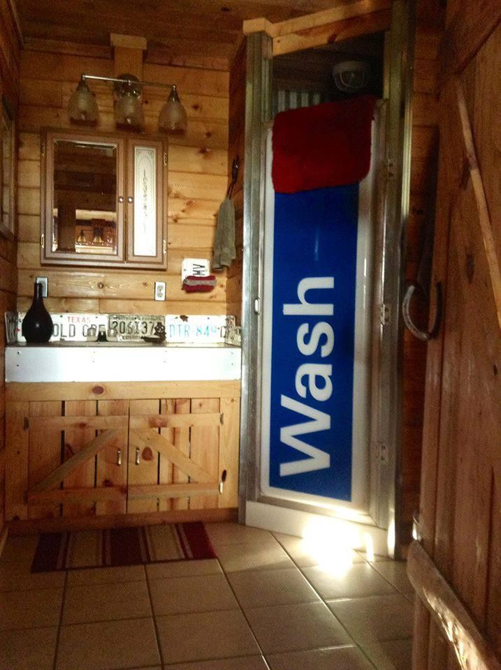 Prime example of upcycling.  From the carwash sign shower door to the old license plate backsplash, this bathroom is a win.
