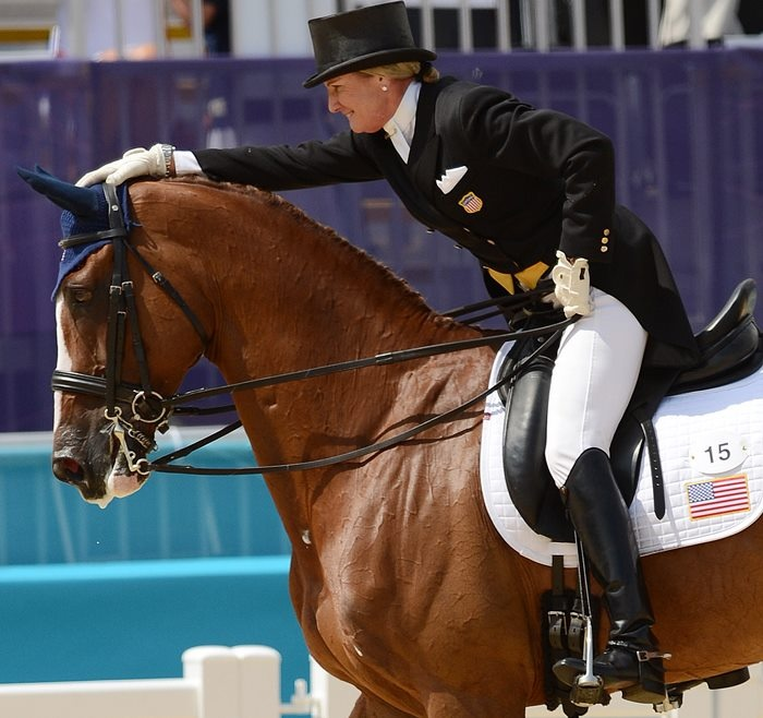 I love this picture of Karen O'Connor and Mr. Medicott - leading the US team after day one of eventing dressage in the 2012 Olympics.