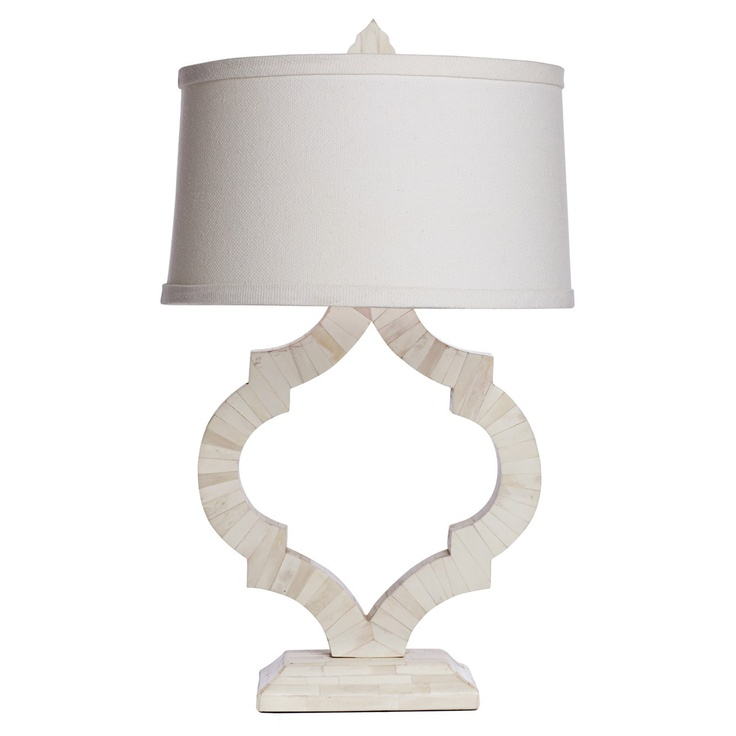 Hand applied bone inlay highlights the beautiful shape of the cass table lamp unique and intriguing it boasts a hand applied natural bone inlay that