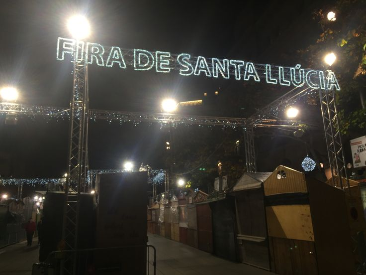 "This banner of lights spells out ""Fira de Santa Llúcia,"" which also translates from Catalan as the ""Fair of St. Luke."" It is the entrance sign to the Christmas markets in the gothic quarter."