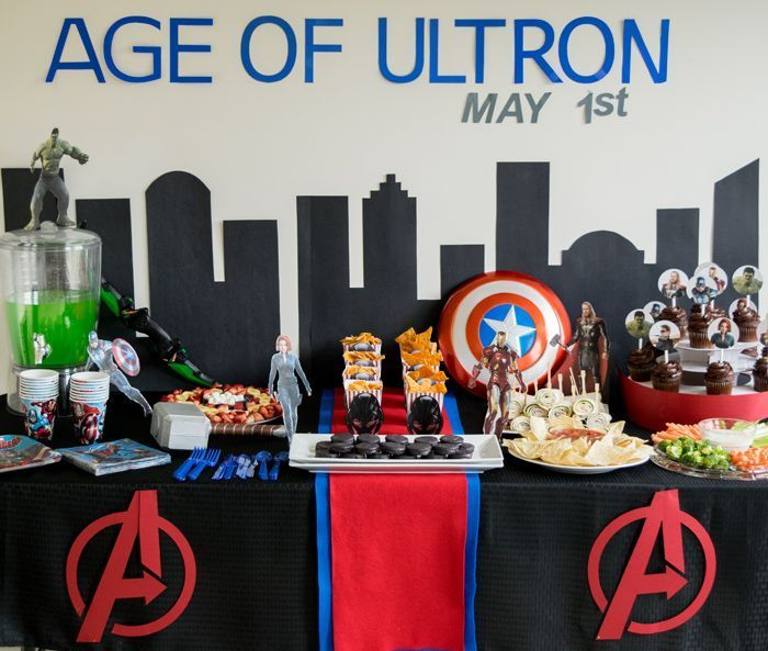 Avengers Birthday Party Table Ideas - including party food, favors, easy avengers party decorations. Love the cutout characters and backdrop.