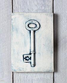 Blue key plaster cast tile