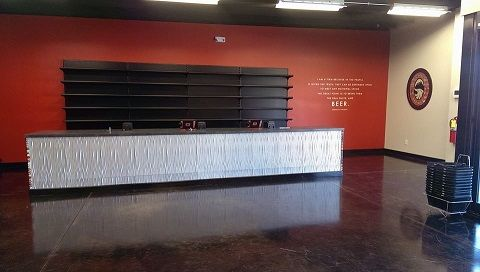 """Mallory ordered the backsplash panels from backsplashideas.com and chose the brushed nickel finish.  She wrote, """"We loved it! Shipping was super fast and efficient. We actually used it to decorate the front of our register counter at the new Liquor store we opened. We've had tons of compliments on it! """""""