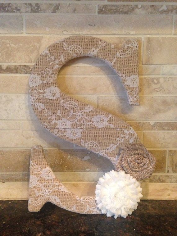 9.5 letter covered in burlap with 3 flowers these make great baby shower gifts and decor and also pretty for weddings and bridal showers.