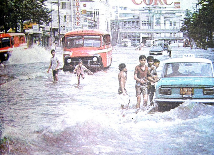 Children play in flood waters along Nicanor Reyes facing Espanya in 1975.Children Play