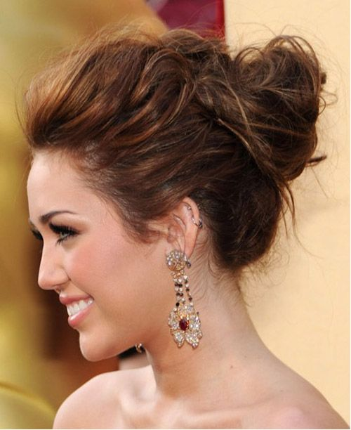 miley cyrus updo... if only she would have not gotten a haircut that looks like she tripped and fell on a weedwacker.