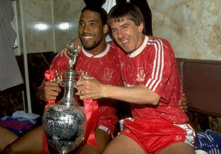 John Barnes and Peter Beardsley with the league championship trophy in 1990. Their LAST title since now!!