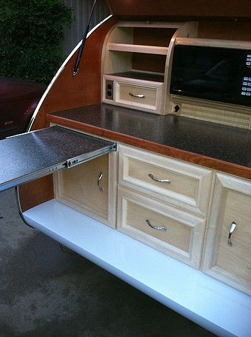 At Juno Custom Teardrops customers can  customize their dream teardrop trailer galley. Customizing everything from stain, custom storage, lighting, refrigerators, stoves, even sinks. Once people see a custom Juno teardrop galley, they never forget.