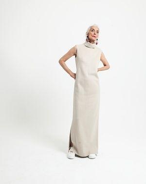 """Long cream dress, £115, <a href=""""http://cosstores.com/"""">cosstores.com<br></a>Trainers, £98, <a href=""""http://jigsaw-online.com/"""">jigsaw-online.com</a><a href=""""http://www.jigsaw-online.com/product/leather-trainers/J27068_WH000"""">http://www.jigsaw-online.com/product/leather-trainers/J27068_WH000<br></a>Earrings, £210, marni.com"""