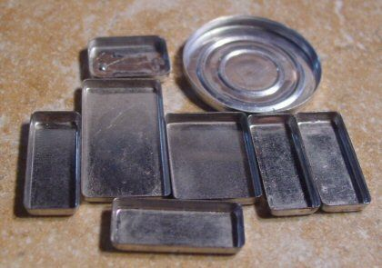great upcycling idea: save the metal tins from makeup containers to use as jewelry bezels