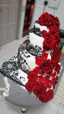 White with black lace wedding cake, and (red) roses for a spark of color