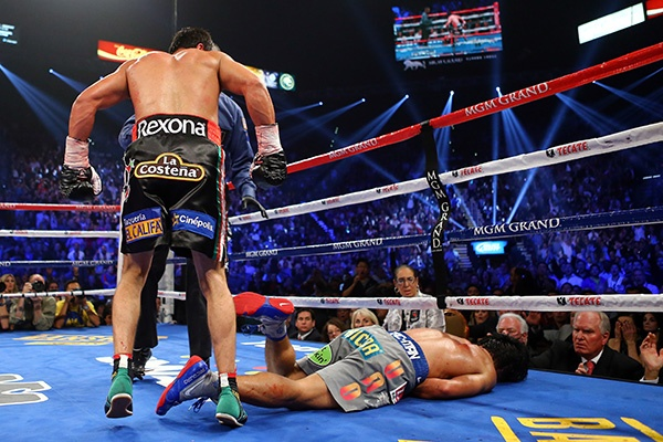 DECEMBER 8: MARQ'ED MAN -- Manny Pacquaio, right, was dropped to the canvas by Juan Manuel Marquez, left, in the sixth round of their welterweight fight at the MGM Grand in Las Vegas. Pacquaio, who was knocked out cold, suffered his second consecutive defeat (he lost a controversial decision to Timothy Bradley in June) and his first in four bouts against Marquez. (Photo by Al Bello/Getty Images)