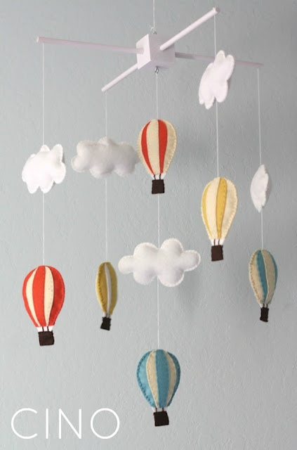 Air balloons and clouds mobile. nice and colorful to catch baby's eye.