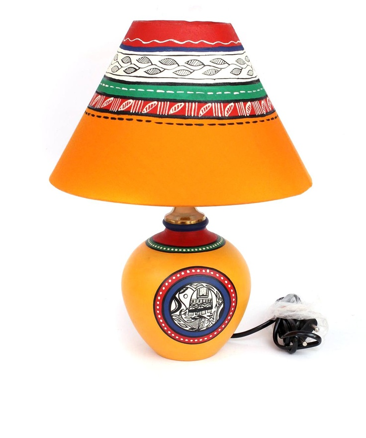 """BRAND: Sourcing India  CATEGORY: Hand Painted Table Lamp  COLOUR: Orange And Multi  MATERIAL: Warli Art Terracotta  SIZE: Lamp:(Dia x H) 5"""" x 7.5"""" Shade : (Dia x H) 10"""" x 6"""""""