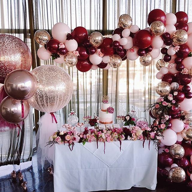 A divine set up of rose gold, burgundy and baby pink balloon.