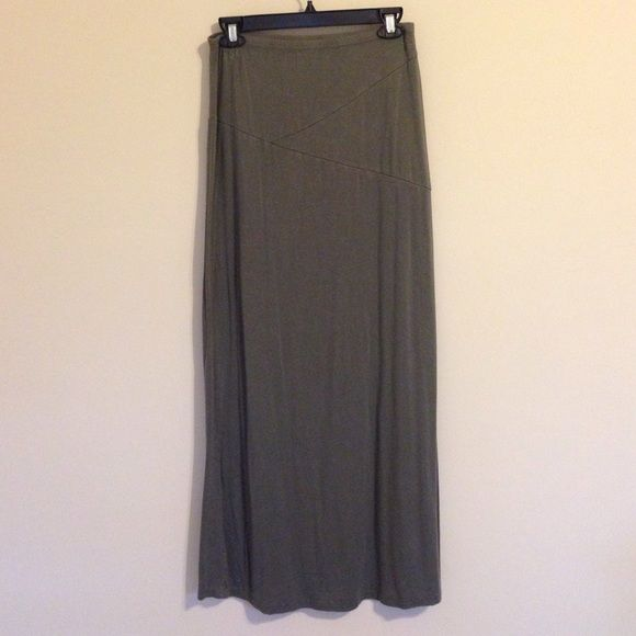 Olive Maxi Skirt It has a thin elastic waist band with stretch all over, it is a faded Olive color, perfect neutral for fall! Cotton On Skirts Maxi