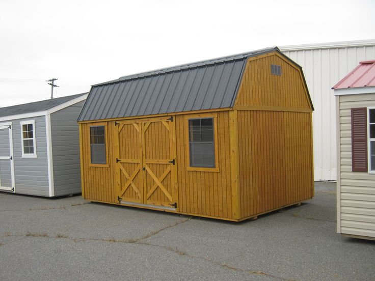 Sheds Direct lofted barn with gray metal roof and doors on the side!
