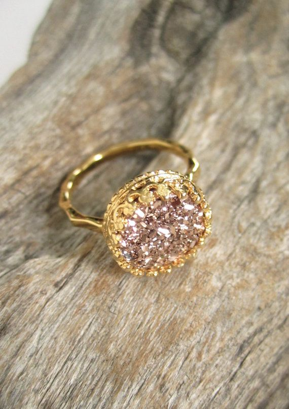 Gorgeous, rose gold druzy quartz is hand set inside an intricate gold vermeil crown bezel along a thin, hammered ring band. Natural, druzy gemstone is vapor coated with titanium to bring out a brilliant, consistent rose gold color. Druzy is 10mm round and unbelievably sparkly. 18K gold