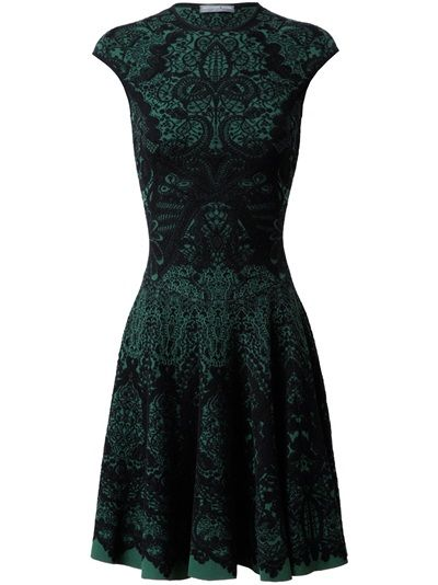 Green wool-blend knit dress with black scrolled baroque print by Alexander McQueen. Round neck. Sleeveless. Defined waist. Lightly pleated skirt. No fastenings