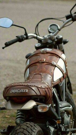 Really cool leather work on a vintage looking Ducati motorcycle
