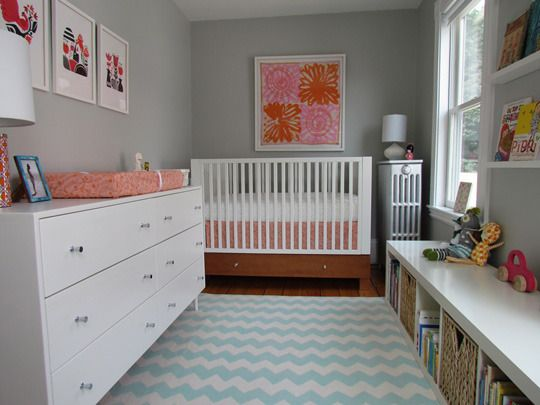 such a cute modern nursery....love the chevron rug and the books on the wall and the bookcase used a bench :)