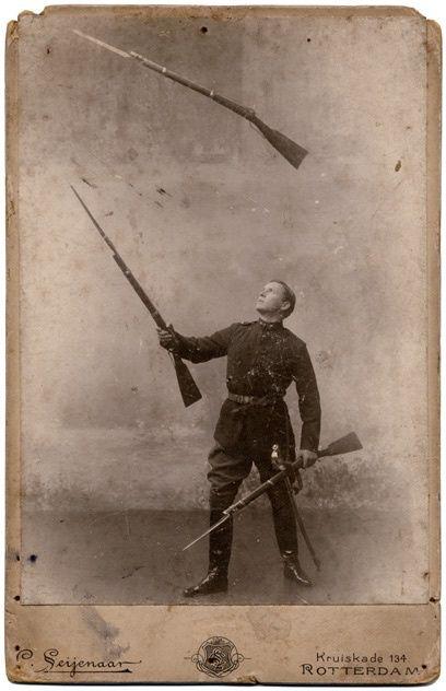 Juggling rifles. Late 1800s.    http://semioticapocalypse.tumblr.com