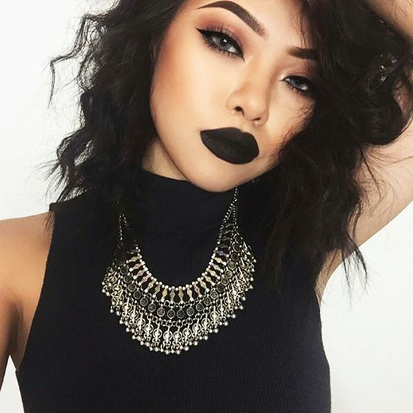 Black lipstick trending as a bold holiday look.