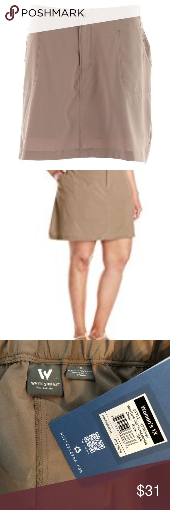 "White Sierra West Loop Trail Skort 1X size 16 Tan White Sierra Women's West Loop Trail Skort features a feminine touch added to the practicality of your favorite hiking shorts. The elastic in the back waist gives you a custom fit that rests below the natural waist and the attached interior shorts give you the added coverage a skirt can't provide. Soft 92/8 polyester/elastane poplin weave provides sun protection. Zippered hip pocket. Length: 17"". Inseam: 5.5"".  Waist 33.5"" (also has elastic…"