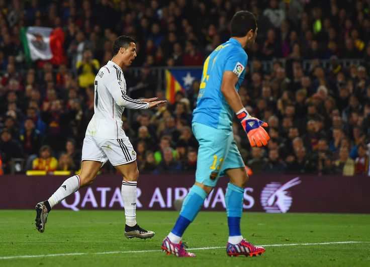 Claudio Bravo of Barcelona looks on as Cristiano Ronaldo of Real Madrid CF celebrates as he scores their first and equalising goal during the La Liga match between FC Barcelona and Real Madrid CF at Camp Nou on March 22, 2015 in Barcelona, Catalonia.