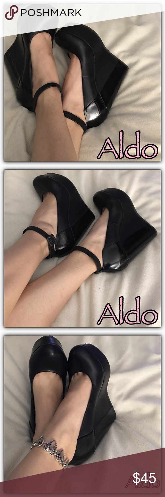 {Aldo} Black Wedge Shoes Super cute black wedges from Aldo's. The back heel part is black patent leather and the rest is the regular soft genuine leather. These gorgeous shoes can either be worn with the ankle strap and buckle as MaryJanes wedges or without ankle strap as just plain slip on wedges. EUC. ALDO Shoes Wedges