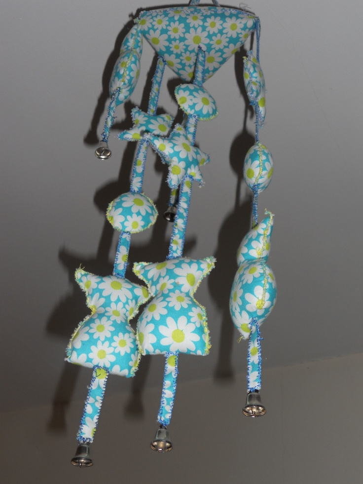 A mobile made in fabric and sponge, swede by hand and with lovely bells in the end