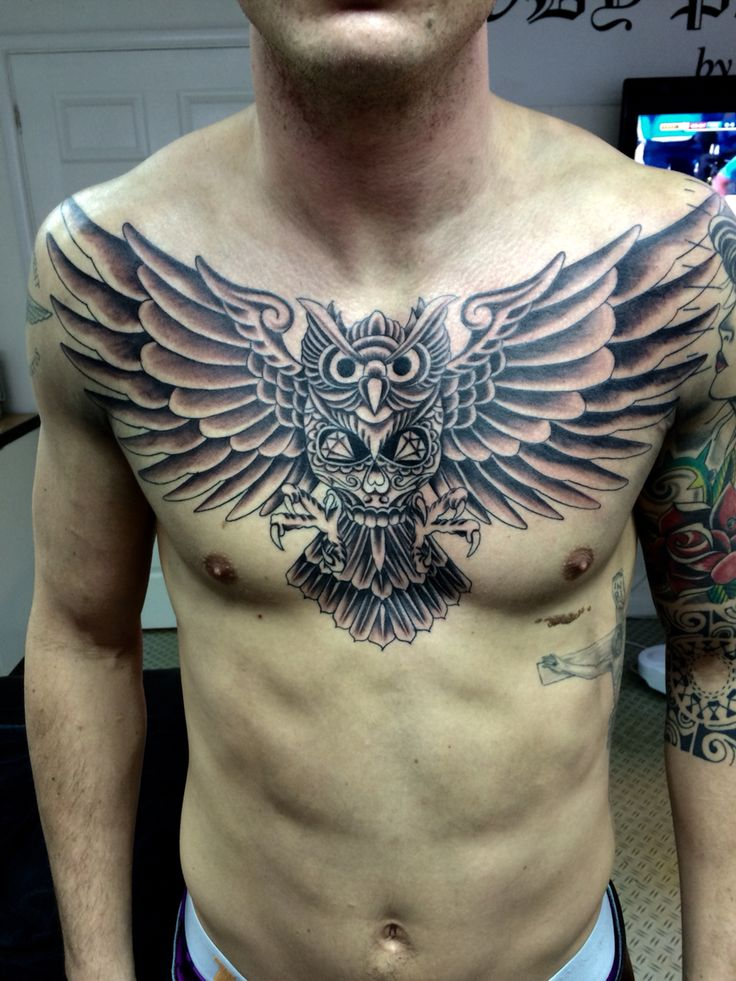 Owl chestpiece tattoo