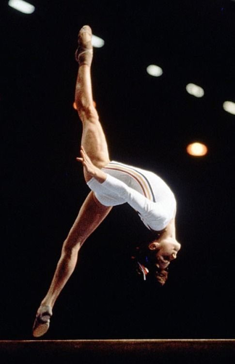 14-year old Romanian gymnast Nadia Comăneci at the XXI Olympiad in Montreal, Canada - July 22, 1976 During a team competition on July 18, Comaneci's routine on the uneven bars was awarded a perfect ten. It was the first time in modern Olympic gymnastics history that the score had ever been awarded. When Omega SA, the traditional Olympics scoreboard manufacturer, asked before the 1976 games whether four digits would be necessary for gymnastics, it was told that a perfect 10.00 was not…