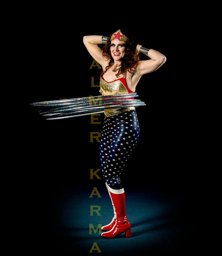 Wonder Woman hula hooper to hire for festivals, corporate events and Superhero themed parties. www.calmerkarma.co.uk Tel:  0203 602 9540
