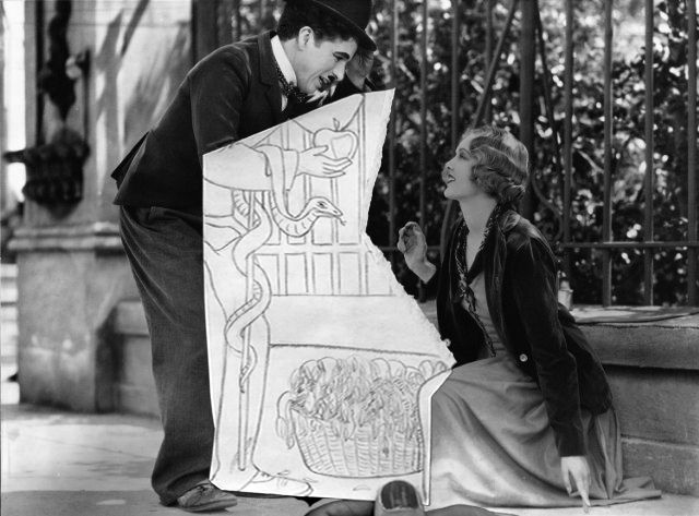 Black and white Charlie Chaplin film still with Adam and Eve themed illustration