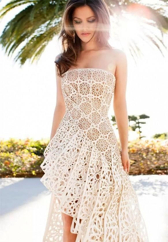 Painstakingly handcrafted bride dresses for 2014, white gown with flower-shaped cutouts wedding dresses.