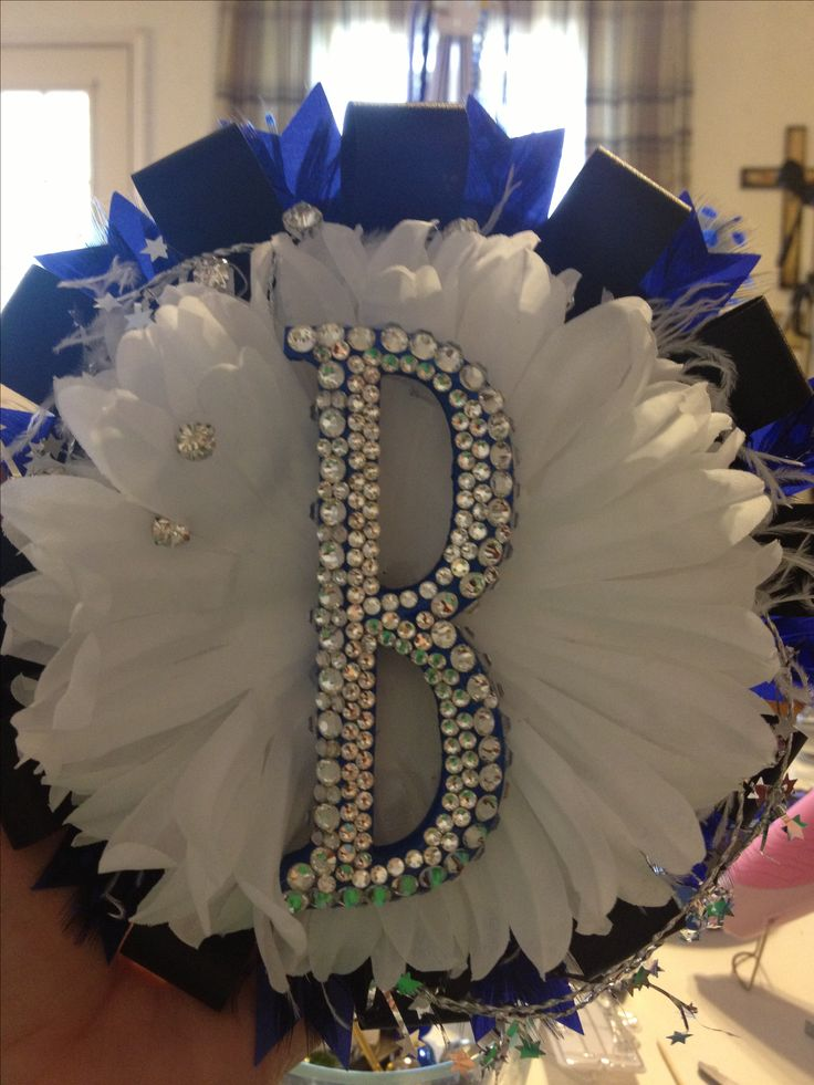 Homecoming Mum Trends: Remove the top layers of the mum and flatten it out  to add a monogram. B for Becca. (Bling is another mum trend.